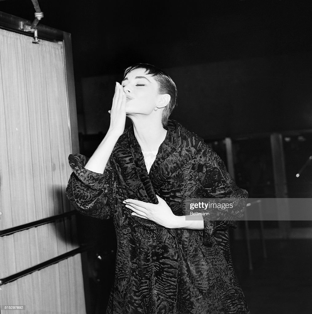 Audrey Hepburn blowing kiss Getty Images