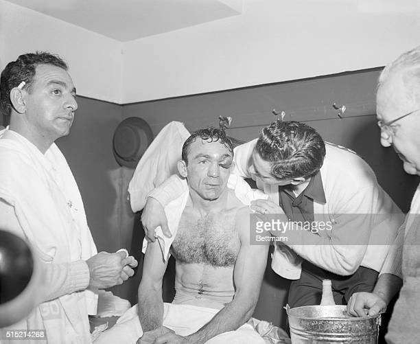 Carmen Basilio is comforted by his manager John DeJohn in the dressing room after Basilio lost his middleweight title to Sugar Ray Robinson by a...