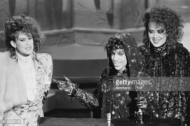 3/25/1985Los Angeles CA Prince and members of his group accept their Oscar for Best Original Song Score for 'Purple Rain'