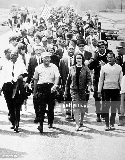 Montgomery, Alabama: Carrying the American flag civil rights marchers arrive at their goal the State Capitol climaxing their 5-day long Selma to...