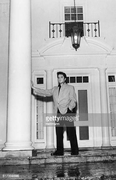 3/26/1957Memphis TNA thoughtful Elvis Presley leans against a massive pillar on the front porch of his traditional southernstyle home Graceland at...