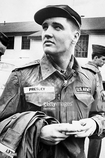 Fort Chaffee, AR: Private Elvis Presley contemplates his next two years of army service while awaiting issue of more Army clothing. Presley was sent...