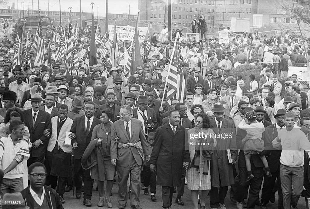 Dr. Martin Luther King (C) leads thousands of civil rights demonstrators out on the last leg of their Selma to Montgomery 50-mile hike. Others identifiable in the front row include John Davis (2nd from L) of SNCC, King's aide Reverend Ralph Abernathy (3rd from L), Dr. Ralph Bunche (5th from L), Mrs. King (next to her husband) and Reverend Hosea Williams (carrying little girl, R).