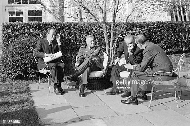 Washington, D.C.: Shown here engaged in conversation in the White House garden are : Vice President Hubert Humphrey, General Creighton W. Abrams,...