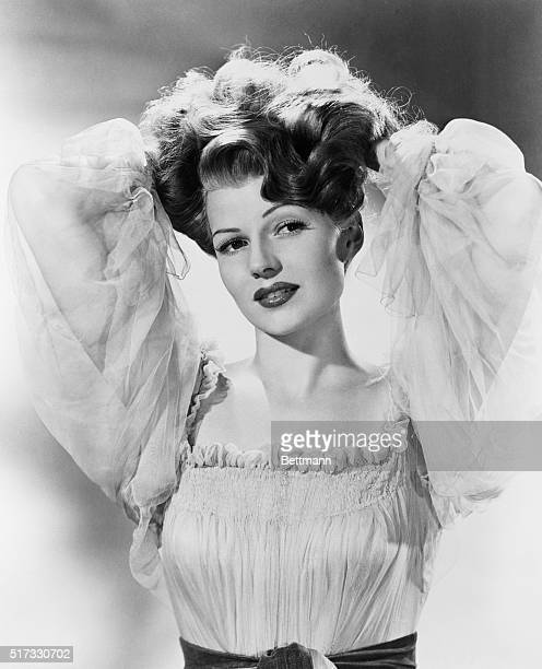 Screen star Rita Hayworth whose titan tresses have brought her the title of America's number one redhead The selection was made by the Coiffure...