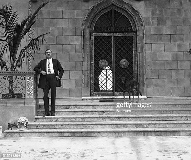 Sarasota, FL- John Ringling, of the famous Ringling Brothers, Barnum and Bailey Circus, on the steps of his beautiful estate at Sarasota, FL. With...