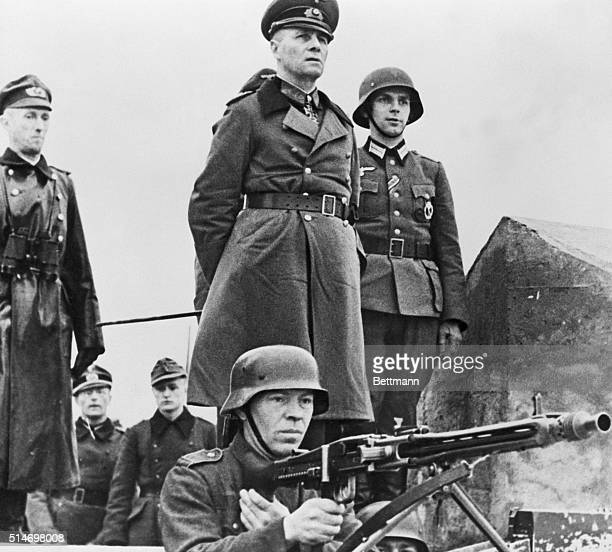 3/28/1944Gen Erwin Rommel with staff as they inspect Atlantic Sea Wall installation in France BPA