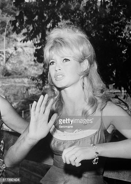 3/28/1964Buzios Brazil Film star Brigitte Bardot of France gestures as she describes recently purchased apartment in the Enchanted Valley to...