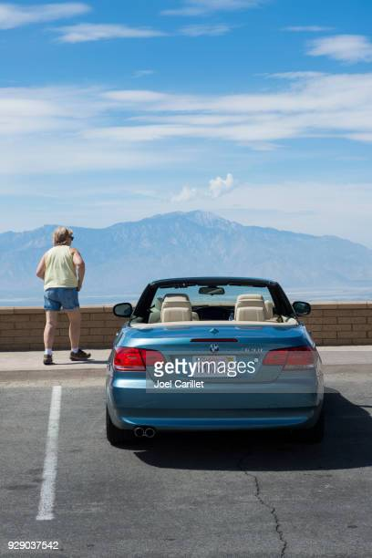 bmw 328i at scenic overlook in joshua tree national park - bmw stock pictures, royalty-free photos & images