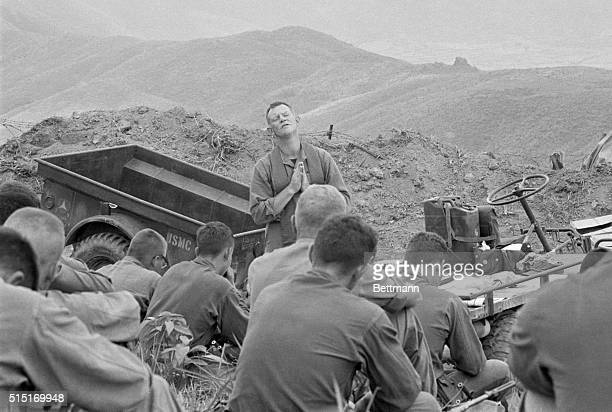 3/29/1965Da Nang South Vietnam With a backdrop of rollling hills and barbed wire Chaplain Lt John F Walker strikes a reverent mood as he conducts...