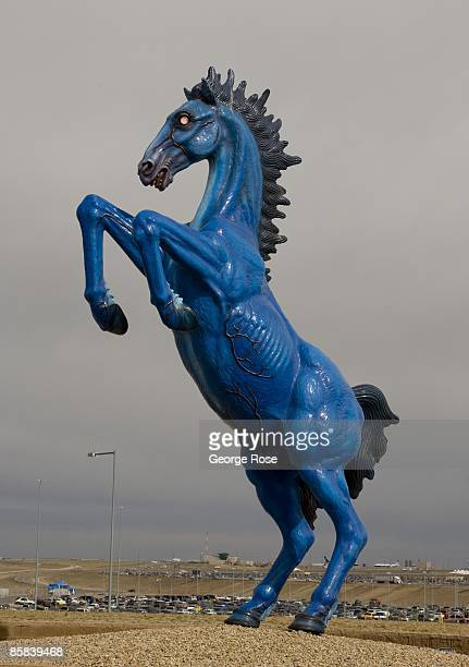 A 32foot cobalt blue with glowing red eyes fiberglass sculpture Blue Mustang by artist Luis Jimenez greets arriving visitors at Denver International...