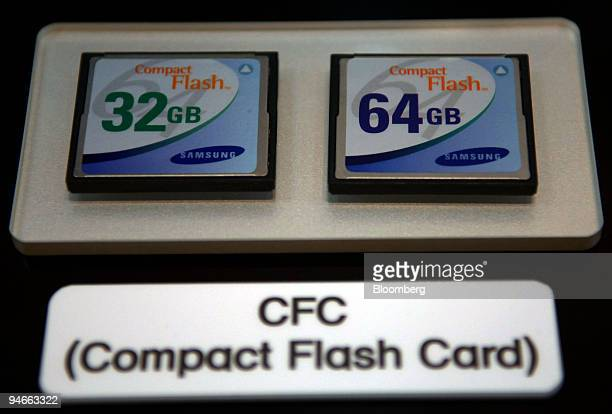 32Gb and 64Gb NAND memory flash cards are displayed during a conference in Seoul, South Korea, on Monday, September 11, 2006. Samsung Electronics Co....