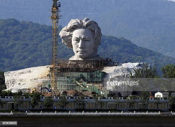 A 32metre statue of late Chairman Mao Zedong in his youth is seen under construction in Changsha central China's Hunan province on November 3 2009...