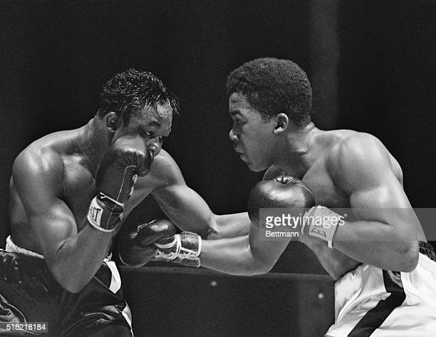 New York, New York- Cuba's Kid Gavilan crouches for another attack on New York's Gene Hairston during their ten-round bout at Madison Square Garden....