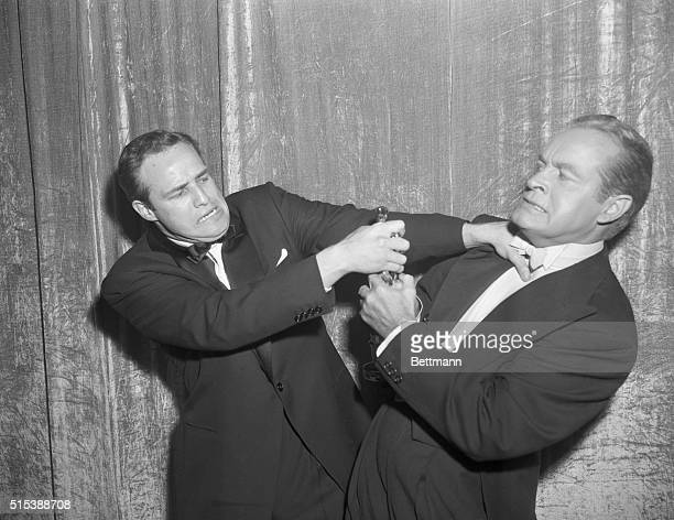 3/30/55Hollywood CA Bob Hope master of ceremonies at the 27th Annual Academy Awards show in Hollywood presents actor Marlon Brando with his Oscar for...