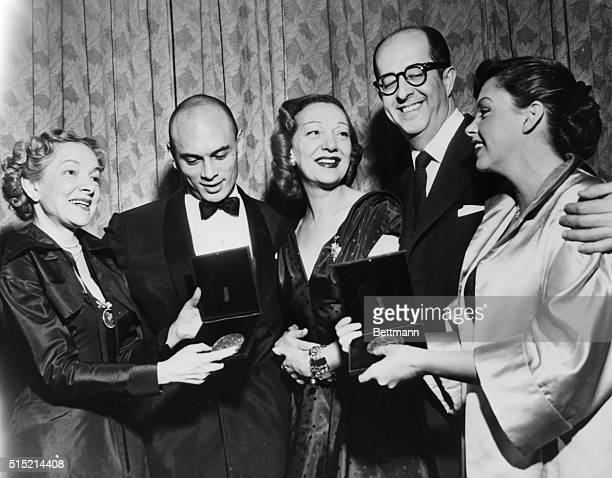 New York, NY- Miss Helen Hayes, president of the American Theatre Wing, is shown presenting Antoinette Perry Awards to some of the winners at the...