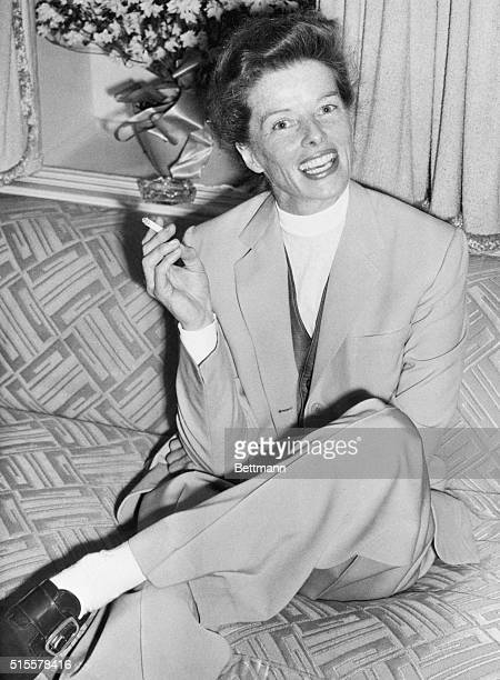 3/31/1952Southampton England Upon arriving aboard the SS America in Southampton screen actress Katharine Hepburn enjoys a cigarette during a press...