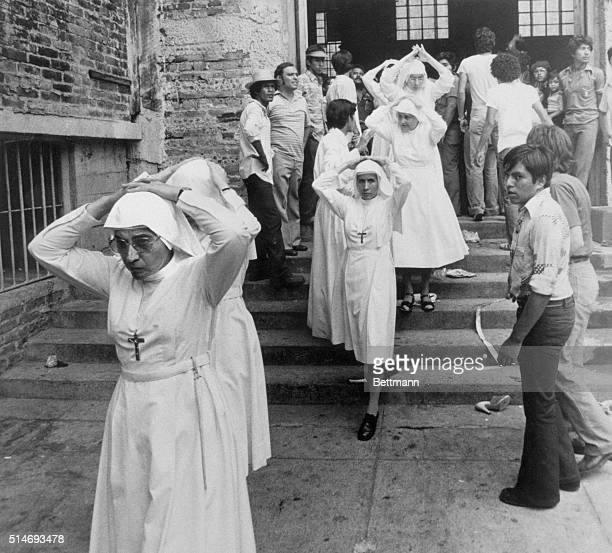 3/31/1980San Salvador Nuns with their hands over their heads leave Metropolitan Cathedral here 3/30 several hours after snipers and explosions set...