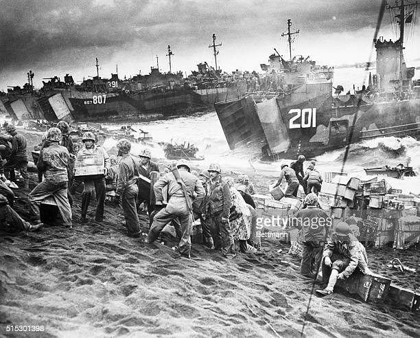 Iwo Jima, Japan-Navy landing craft disgorge tons of supplies onto the shores of Iwo Jima, teeming with activity just a few hours after U.S. Marines...