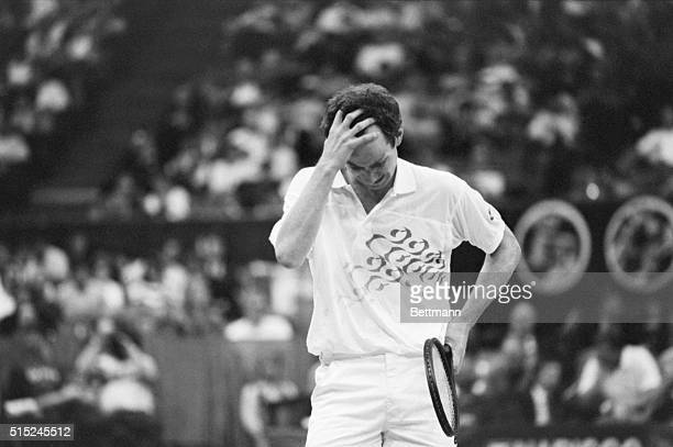 Dallas, TX: A frustrated John McEnroe clutches his head after blowing a point during first set action 3/3 in his in WCT semi-final match against Ivan...