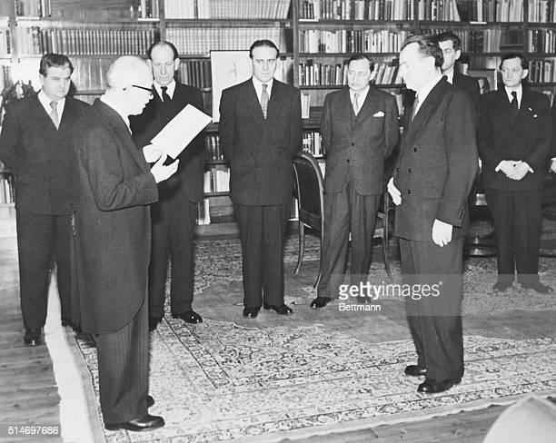 3/3/48Prague Czechoslovakia Faced by Communist Premier Klement Gottwald President Eduard Benes of Czechoslovakia reads a list of new cabinet members...