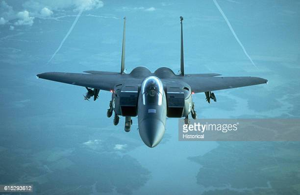 A 336th Tactical Fighter Squadron F15E Eagle aircraft follows behind a KC10A Extender aircraft as it prepares for aerial refueling operations...