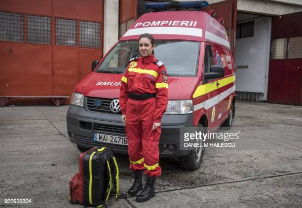 33yearold major plutooner Angelica Simon poses in front of an ambulance at the Inspectorate for Emergency Situations headquarters in Bucharest on...