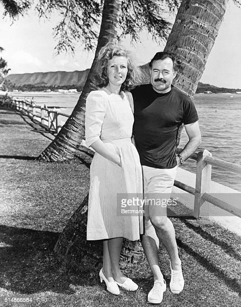 Waikiki, HI: Mr. And Mrs. Hemingway on beach at Waikiki.