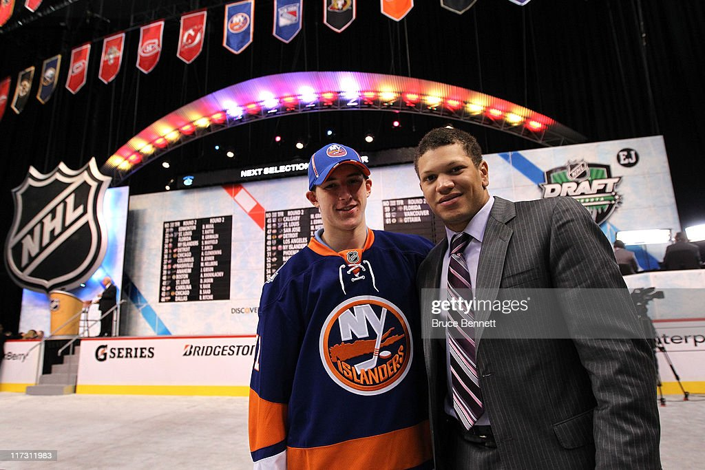 34th overall draft pick Scott Mayfield by the New York Islanders poses with Kyle Okposo during day two of the 2011 NHL Entry Draft at Xcel Energy Center on June 25, 2011 in St Paul, Minnesota.