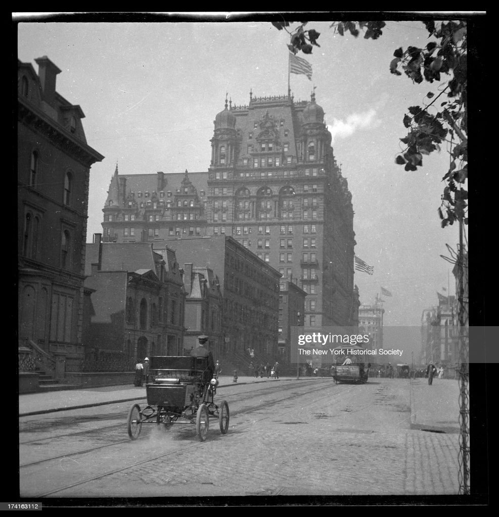 34th Street looking west toward the Waldorf Astoria on Fifth Avenue, early automobile in foreground, New York, New York, late 19th or early 20th century.