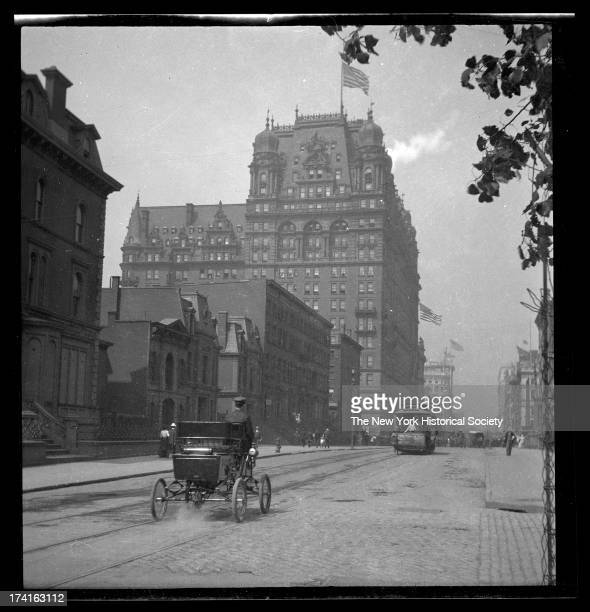 34th Street looking west toward the Waldorf Astoria on Fifth Avenue, early automobile in foreground, New York, New York, late 19th or early 20th...