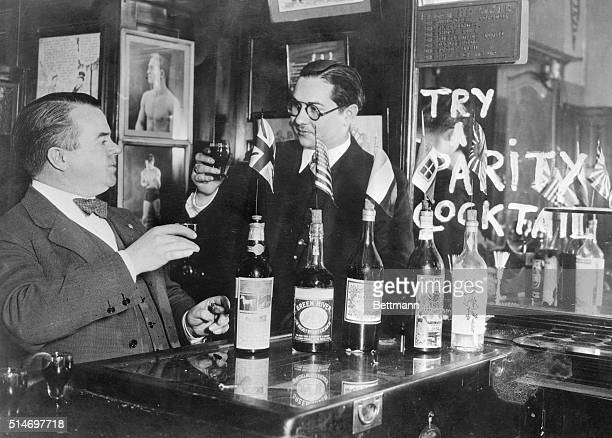 3/5/1930Paris France L to r Harry of Harry's New York bar in Paris initiating Sam Schulman International News Photos' cameraman in Paris to the taste...