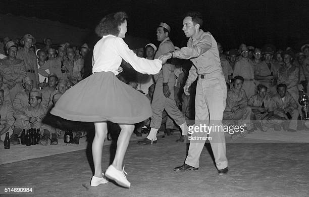 3/5/1943Moumea New Caledonia American yank teaches the jitterbug to a young French colonial girl at the opening of 'The Beer Garden' for US soldiers...