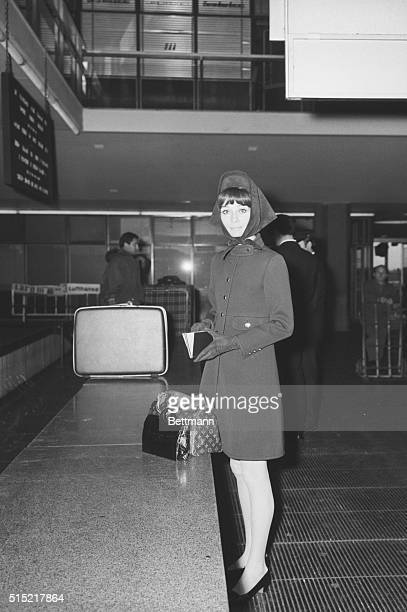 Rome, Italy-Smartly attired, Audrey Hepburn goes through customs at Rome's Airport. The actress is reportedly taking a rest in the Eternal City...