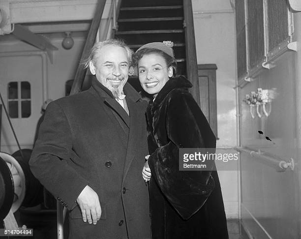 Lena Horne well known nightclub singer and her husband orchestra leader Lennie Hayton pose together prior to sailing aboard the liner Ile De France...