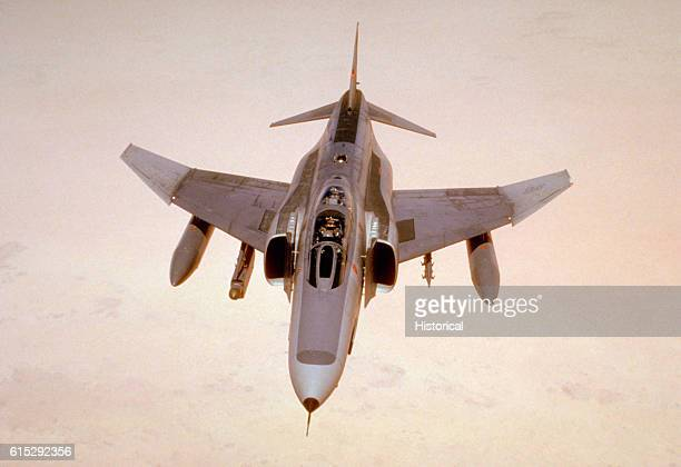 A 35th Tactical Fighter Wing F4E Phantom II aircraft passes over the Saudi desert while on a training flight during Operation Desert Shield The...