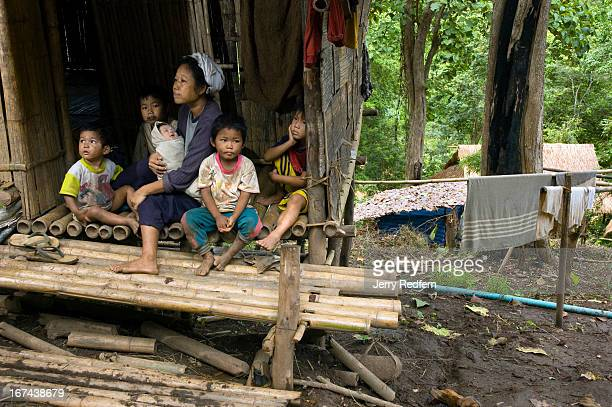A 35yearold refugee mother of seven sits on the stoop with some of her children in the new arrivals section of the camp They have been in the camp...