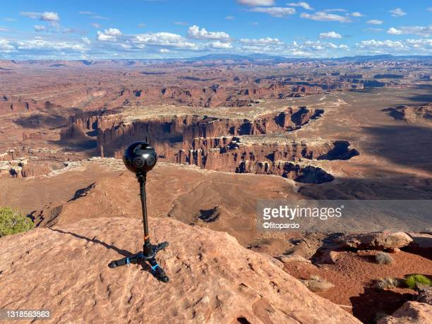 a 360-degree camera sits in the edge of a canyon in canyonlands national park - fitopardo stock pictures, royalty-free photos & images