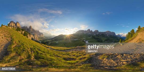 360-degree panorama of mountain roads leading to Passo Gardena mountain pass with Sella group, Langkofel and Pizes de Cir mountain range, Gardena Valley, Dolomites, Unesco world heritage, South Tyrol, Italy