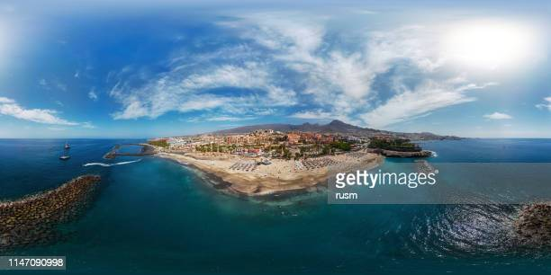 360x180 degree spherical (equirectangular) aerial panorama of costa adeje resort and playa del duque beach, tenerife, canary islands, spain. - tenerife stock pictures, royalty-free photos & images
