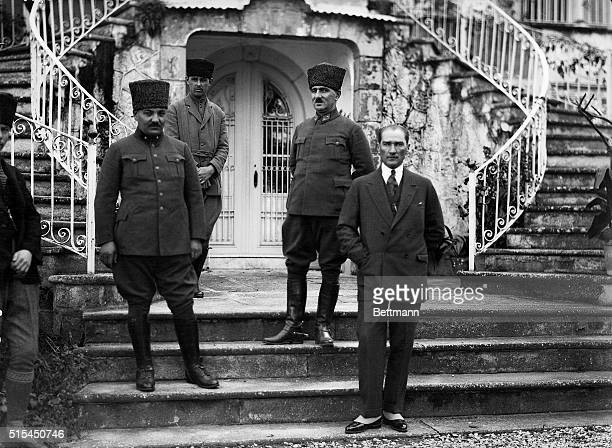 Turkey: Mustafa Kemal Atatürk , founder and President of the Turkish Republic, and officers on outdoor staircase, Smyrna .