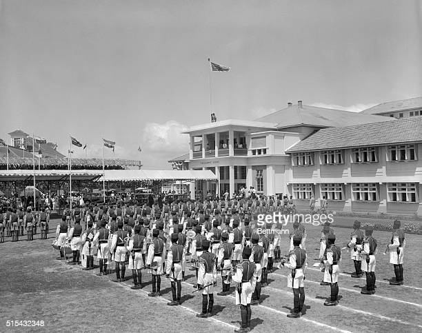 3/6/1957Accra Ghana The royal standard is lowered and the flag of Ghana raised as the Duchess of Kent leaves the assembly building after reading the...