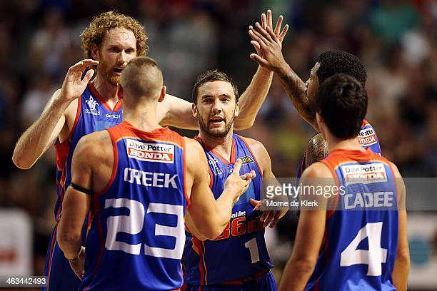 36ers players celebrate during the round 14 NBL match between the Adelaide 36ers and the Townsville Crocodiles at Adelaide Entertainment Centre in...