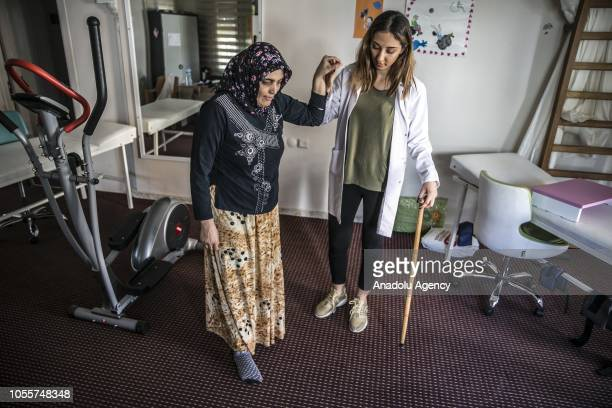 36yearold Fatma Kurum who hasn't felt her legs when she woke up about 10 years ago receives physiotherapy and starts to walk after receiving...