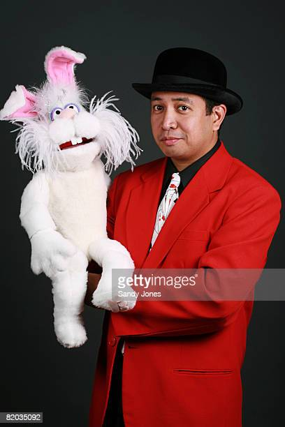36-year-old hispanic magician with a rabbit - ventriloquist stock photos and pictures