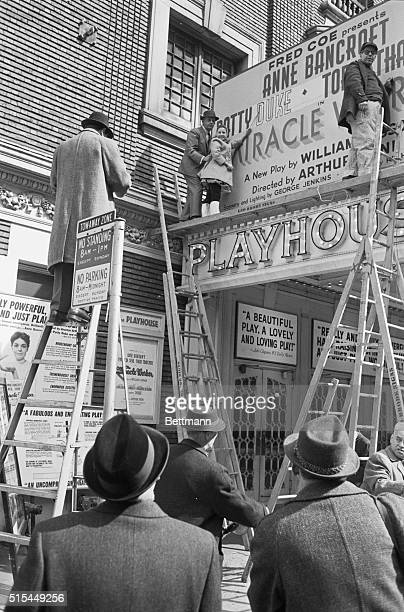 3/7/1960New York New York Standing atop the marquee of the Playhouse Theater Patty Duke helps paint her name on the marquee advertising The Miracle...