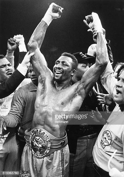 "Detroit, MI: Fists raised in jubilation, Thomas ""Hit Man"" Hearns wears his newly won title belt after defeating Britain's Dennis Andries with a TKO..."