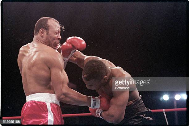 3/7/1987Las Vegas NVJames Bonecrusher Smith digs a right hand to stomach of WBA champion Mike Tyson but gets a hard right to the head in return in...