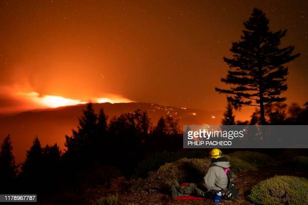 37yearold Alex DeLeon with Engine 342 of the Lake Tahoe Basin Management Unit of the US Forest Service watches the Kincade fire burn on a ridge...