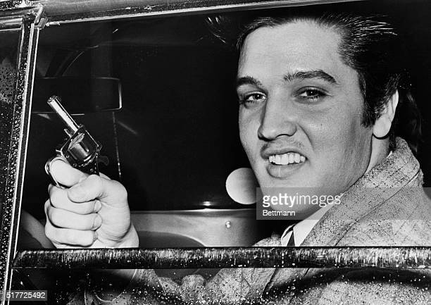 3/8/57Memphis Tennessee Elvis Presley holds the toy pistol which he reputedly wielded during a dispute with Hershell Nixon an 18yearold Marine in...